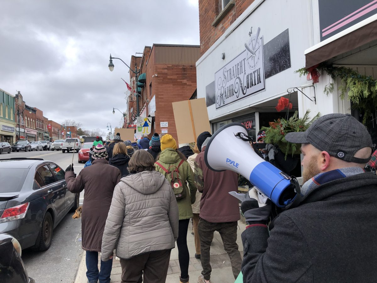 Climate strikers march up Manitoba Street in Bracebridge