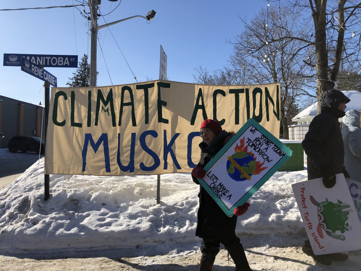 Climate Action Muskoka banner with climate striker in Bracebridge