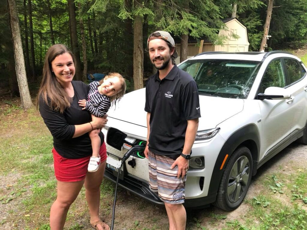 Electric Vehicle enthusiast Mark Walker with his wife Ellen, daugher Meredith and their Hyundai Kona.